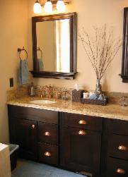 Cary, NC Master bathroom with espresso cabinets, copper hardware, and accents from Pottery Barn and World Market