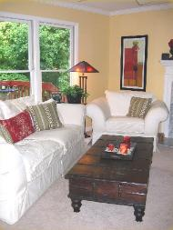 Cary NC living room with Benjamin Moore Straw walls and white slipcovered sofa